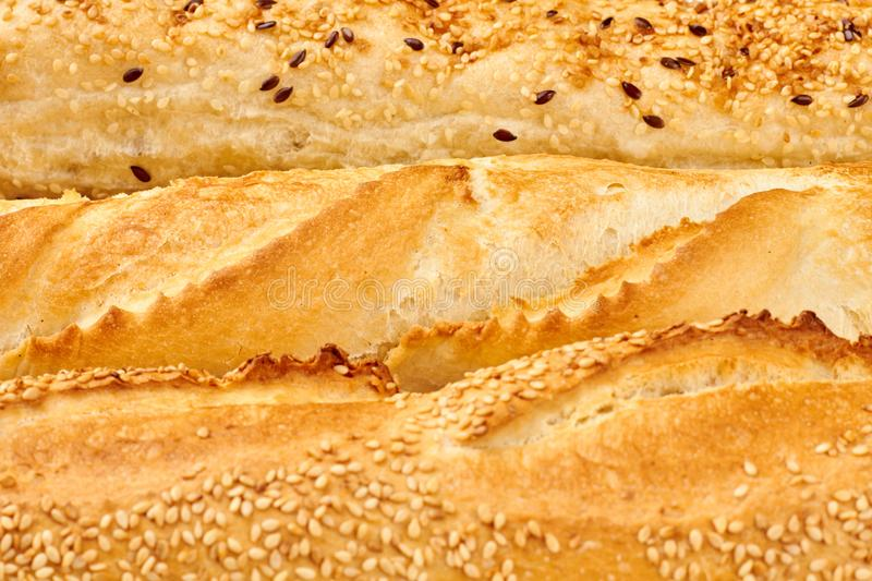 Texture of crusty french baguettes. Golden crust of french loaves and ciabatta royalty free stock photo