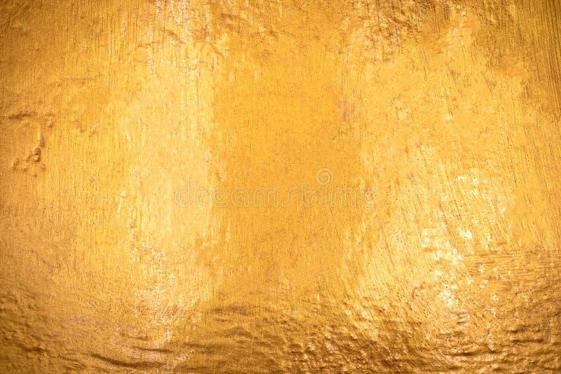 Texture d'or avec le fond en pierre Détail de la surface d'or fait à partir de la roche photo libre de droits