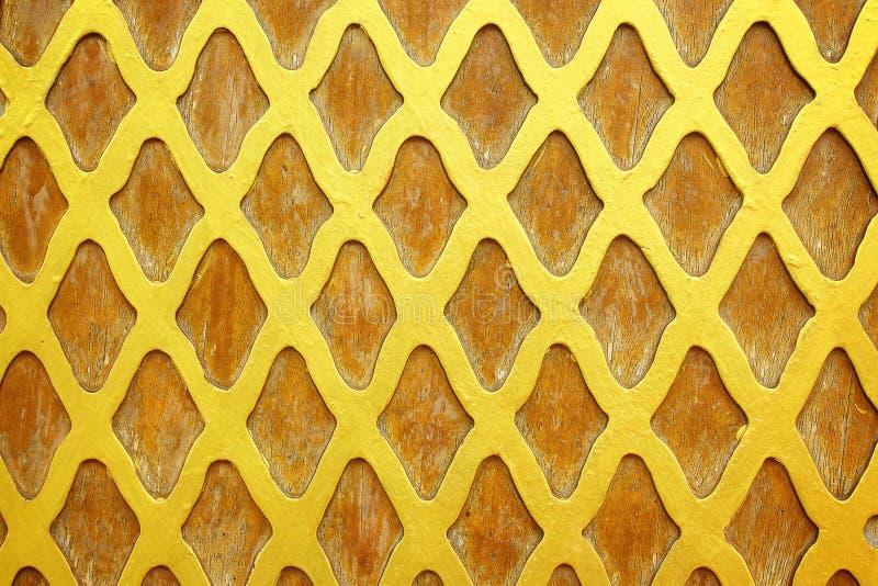 Texture d'or de couche sur le bois images stock