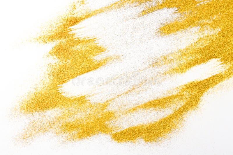 Texture d'or de sable de scintillement sur le fond blanc et abstrait image libre de droits