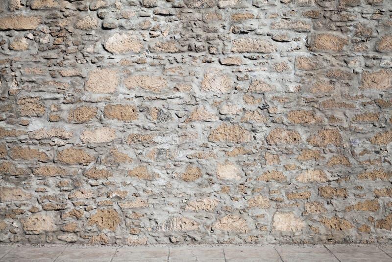 Texture d'un carrelage approximatif de mur en pierre et de plancher photo stock