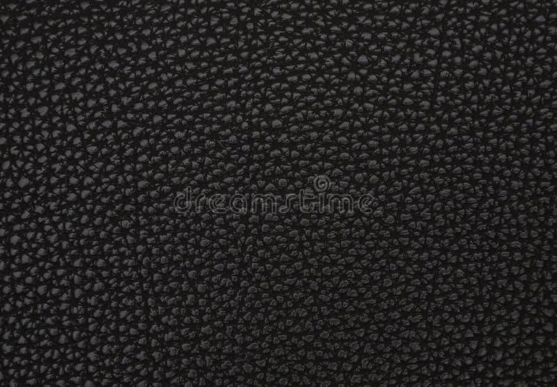 Texture d'un cuir artificiel noir images stock