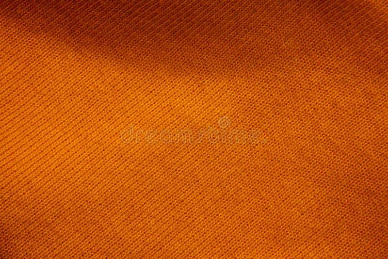 Texture d'un fond orange de tissu photos stock