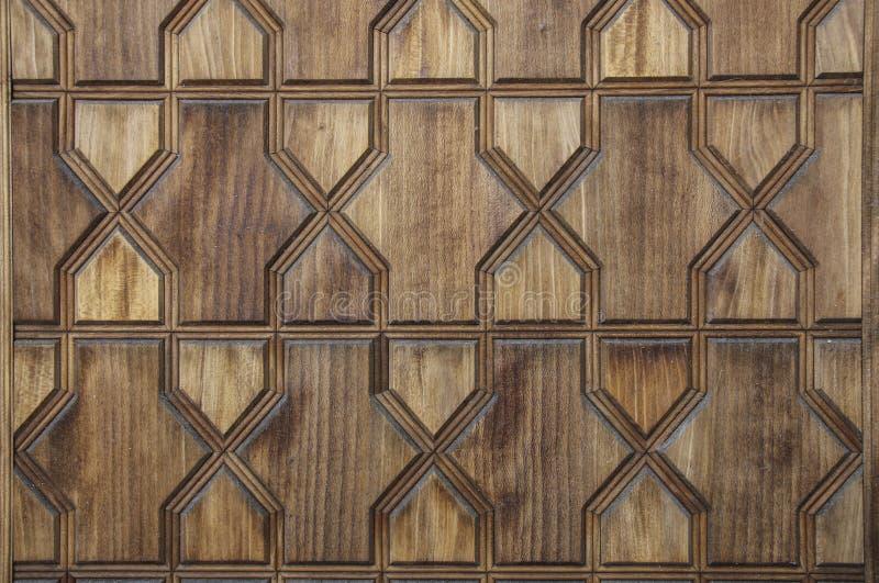 Texture d'un mur en bois avec des découpages sous forme de géométrique image libre de droits