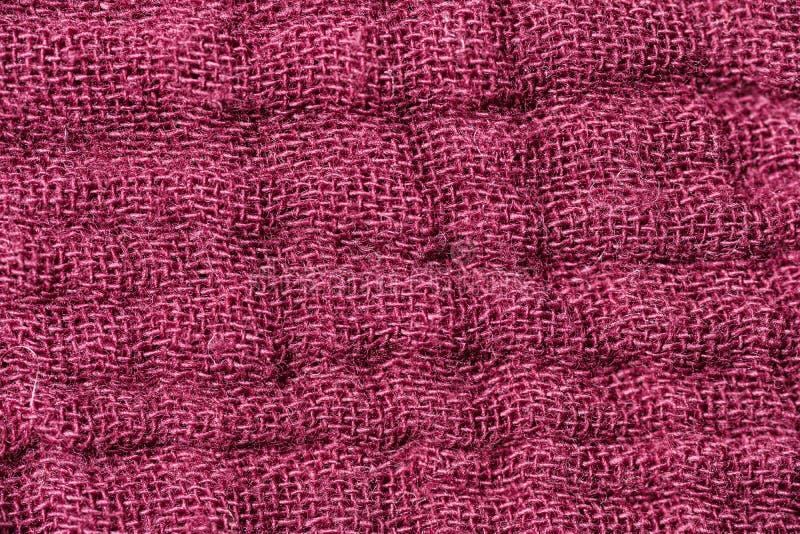 Texture d'un tissu cramoisi images libres de droits
