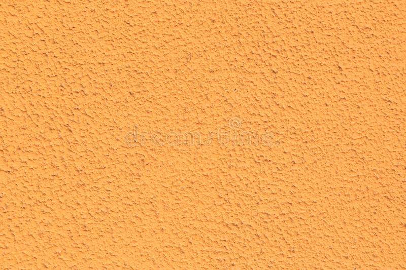 Texture d'une orange de mur Fond poreux photos stock