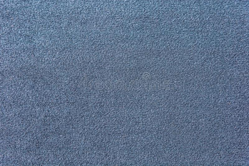 Texture of a dark blue carpet. Close-up of gradient light royalty free stock photo