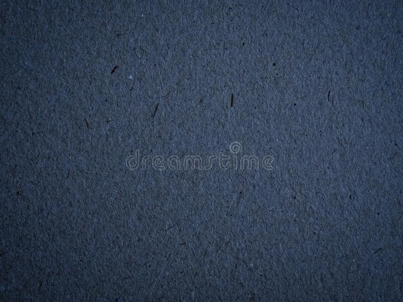 Texture of dark blue crumpled craft paper. stock images
