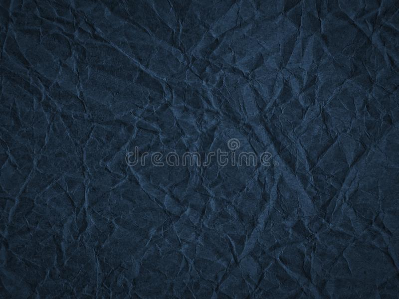 Texture of dark blue crumpled craft paper. stock image