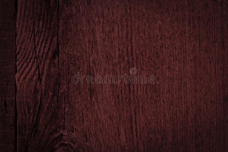 Texture of dark burgundy old rough wood. Mahogany abstract background for design. stock photography