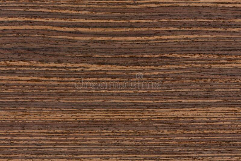 Texture of dark ebony veneer. Natural ebony veneer background. stock images
