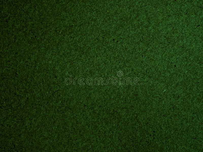 Texture of dark green cardboard closeup, abstract paper background stock images
