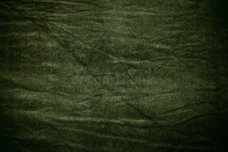 Texture of dark khaki crumpled fabric stock photography