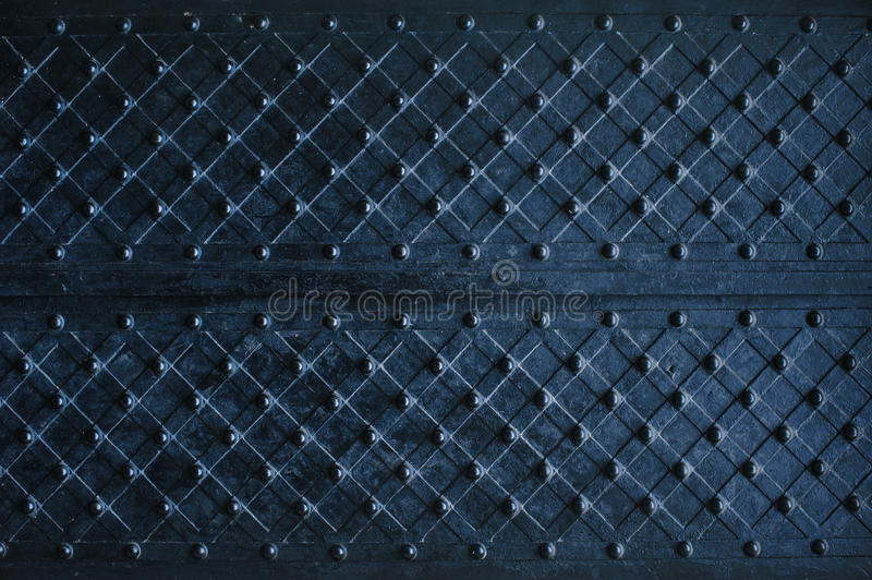 Texture of dark wooden gate with metal strips chipped.  royalty free stock photography