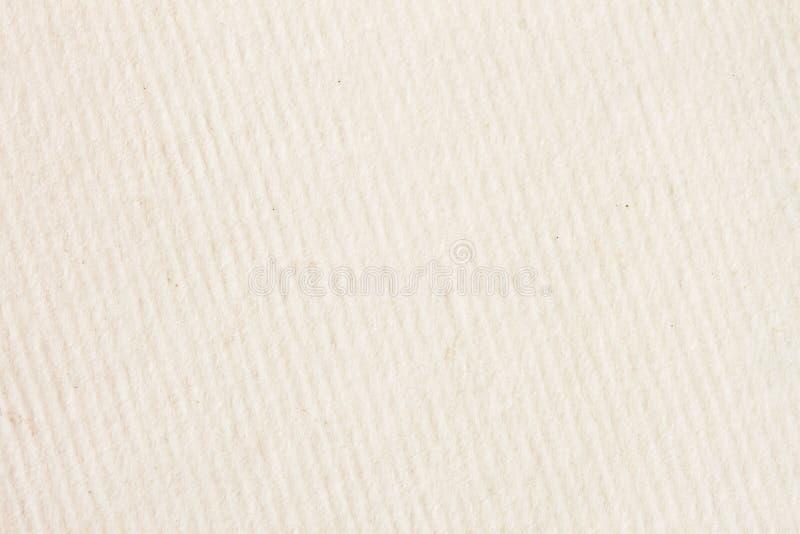 Texture de crème légère dans diagonalement un papier de dépouillement avec de petites inclusions pour l'aquarelle et l'illustrati photo libre de droits
