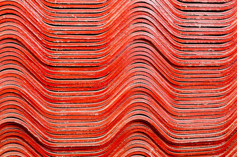 Texture de fond des tuiles de toit rouges de gypse de pile photo stock