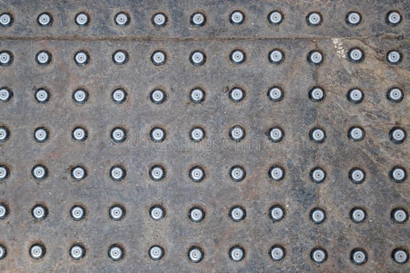 Texture de fond en acier avec des boutons antidérapage photos stock