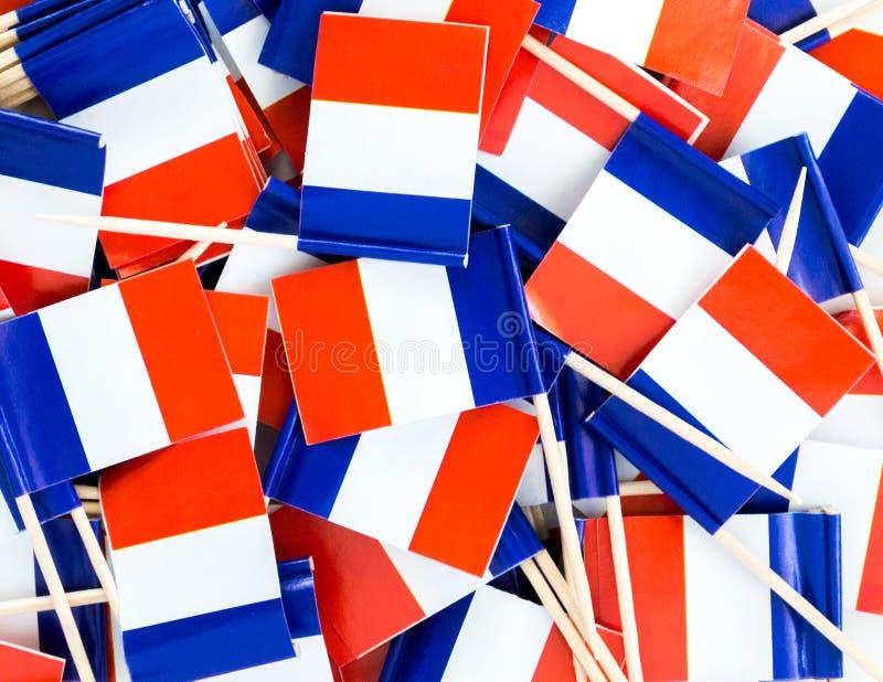 Texture de fond - un pêle-mêle des cure-dents français tricolores de drapeau images stock