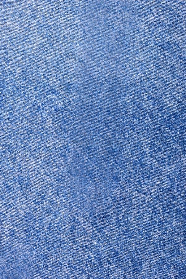 Texture de l'espace vertical de copie de fond bleu-clair de denim de cru de denim photographie stock