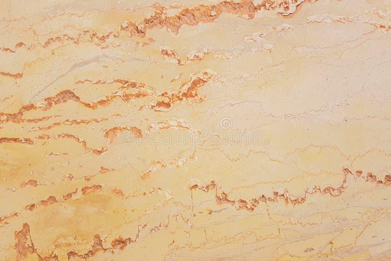 Texture de marbre jaune-orange, structure détaillée de marbre dans naturel modelé photographie stock