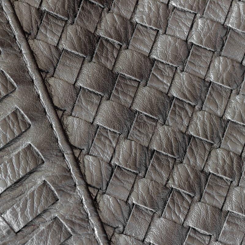 Texture de plan rapproché et de détails en cuir en osier foncés véritables avec des points du sac à main masculin Concept des ach photos stock