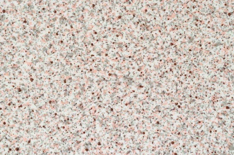 Texture de plastique avec l'imitation de la pierre blanche avec les inclusions grises et roses photos libres de droits