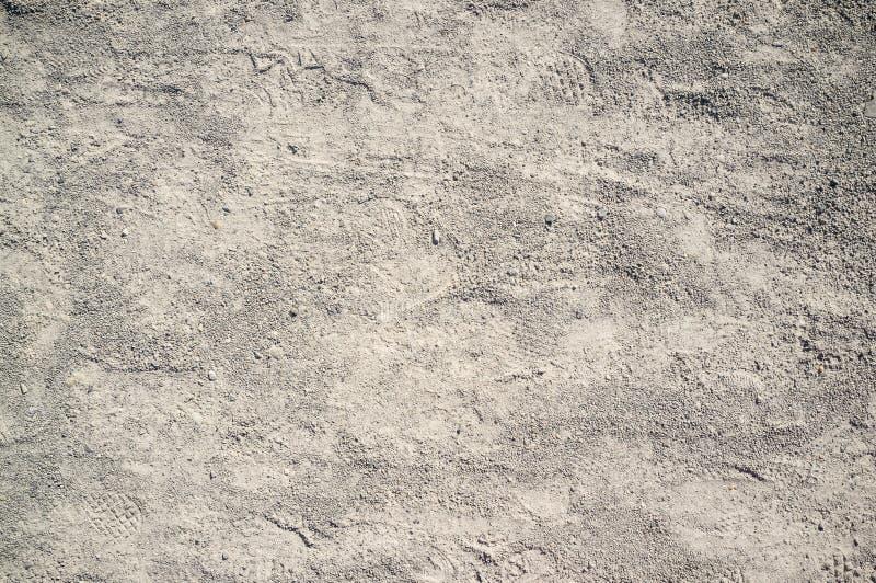 Texture de poussi?reux et de Rocky Road avec des tra?n?es de voiture et de bicyclette photographie stock