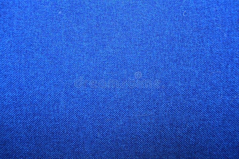 Texture de tissu, fond bleu photos stock
