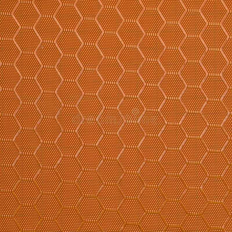Texture de tissu synth?tique Fond de textile orange photos stock