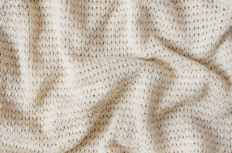 Texture de tissu tricotée par beige de vintage Fond de laine chaud de fil de crochet photo libre de droits