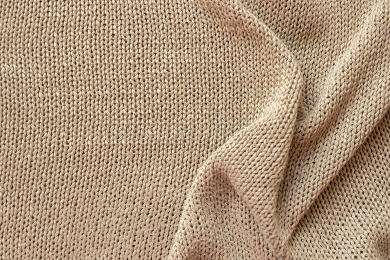 Texture de tissu tricot?e par beige photo stock
