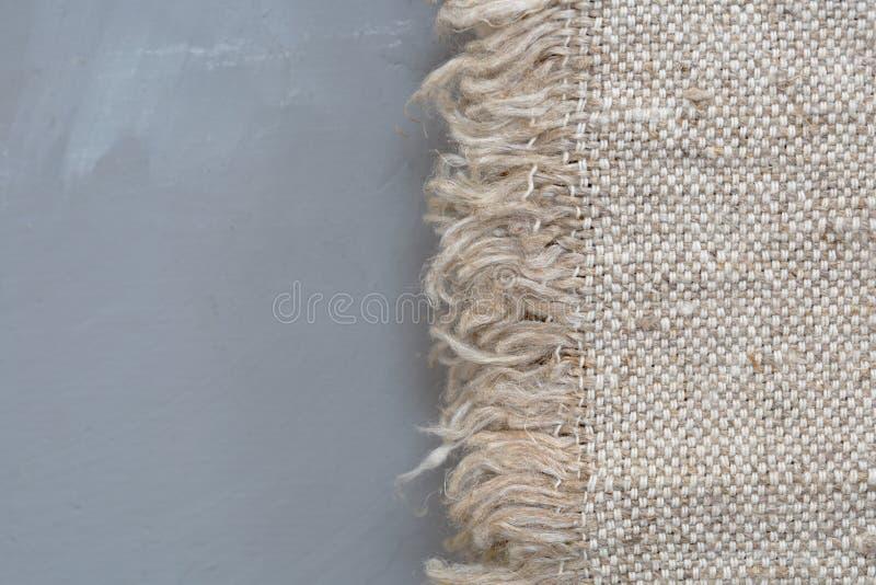 Texture de toile à sac de tissu sur un fond gris Texture de toile de jute Textile de tissu de modèle image libre de droits
