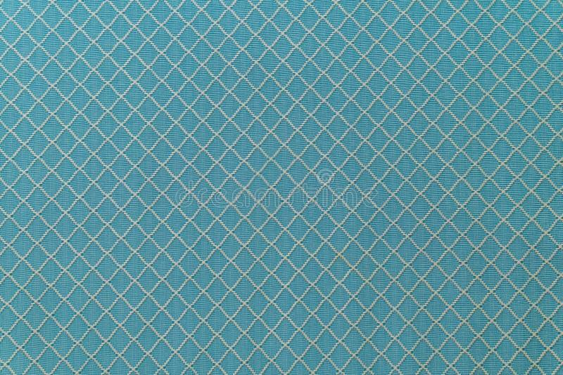 Texture de toile de tissu de sofa bleu pour le fond photographie stock