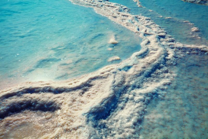 The texture of the Dead Sea salty shore stock photography