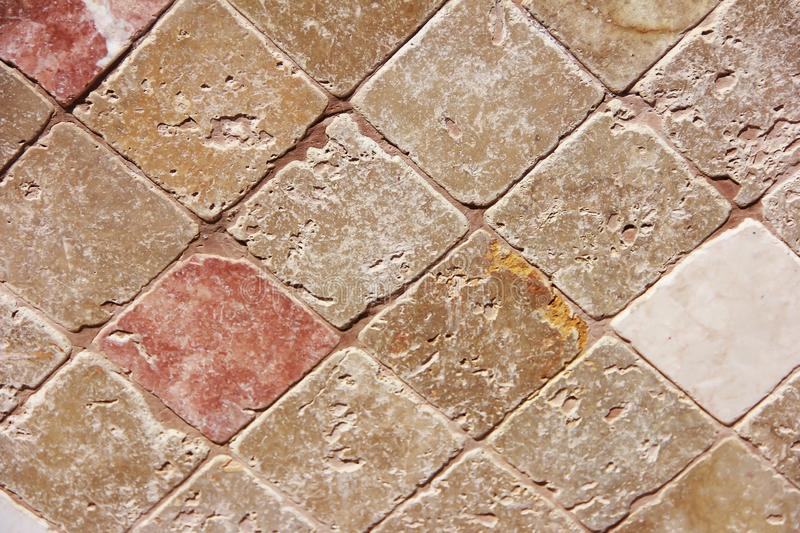 Texture of decorative brown ceramic tile with rhombus patterns, cracks and divorces. Texture of decorative brown ceramic tile with rhombus patterns, cracks and a stock photos