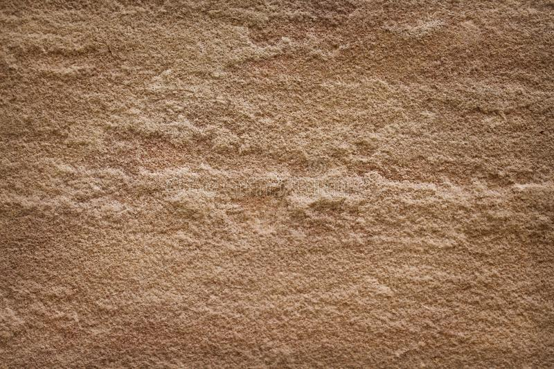 Texture delicate nature rough patterns of old brown sand stone for background royalty free stock photo