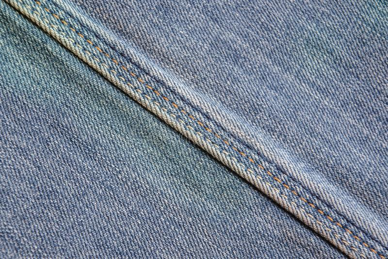 Denim fabric with seam royalty free stock photography
