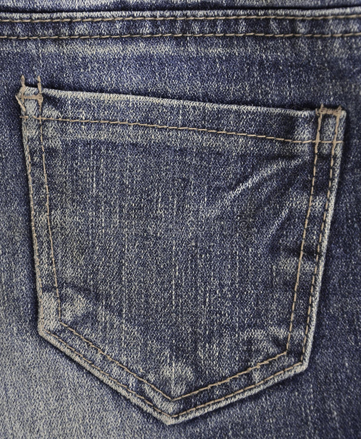 The texture of denim pocket. Texture fragment of denim in classic tones with bright seams of thin fabric and a large pocket. The background image on the stock photos