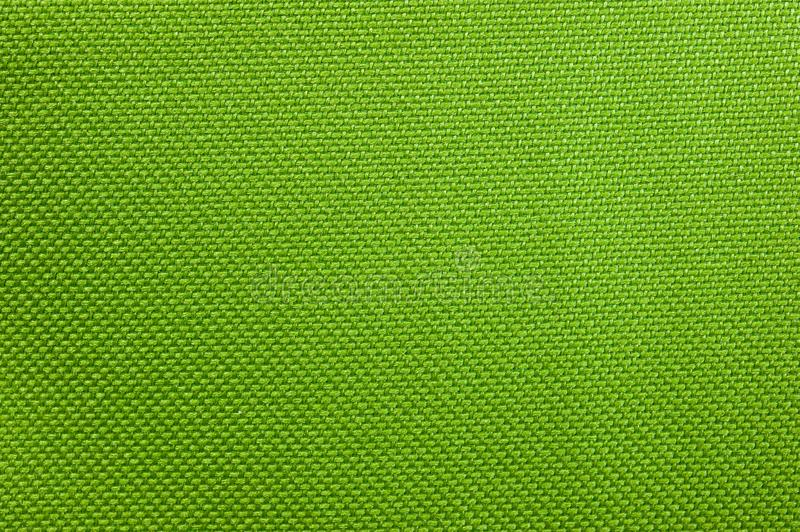 Texture of dense bright green fabric used in thermo bags royalty free stock photo