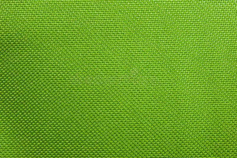 Texture of dense bright green fabric used in thermo bags stock photo