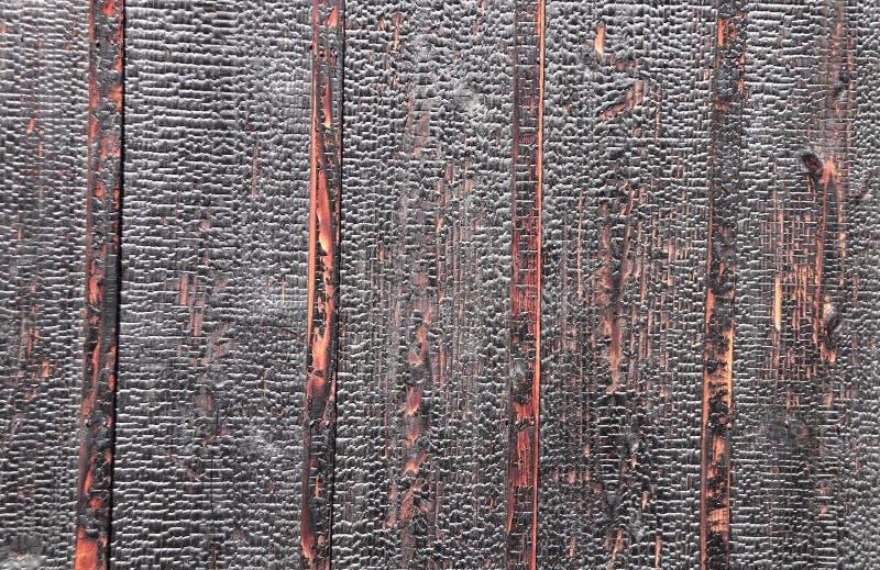 Texture des conseils en bois brûlés photographie stock libre de droits