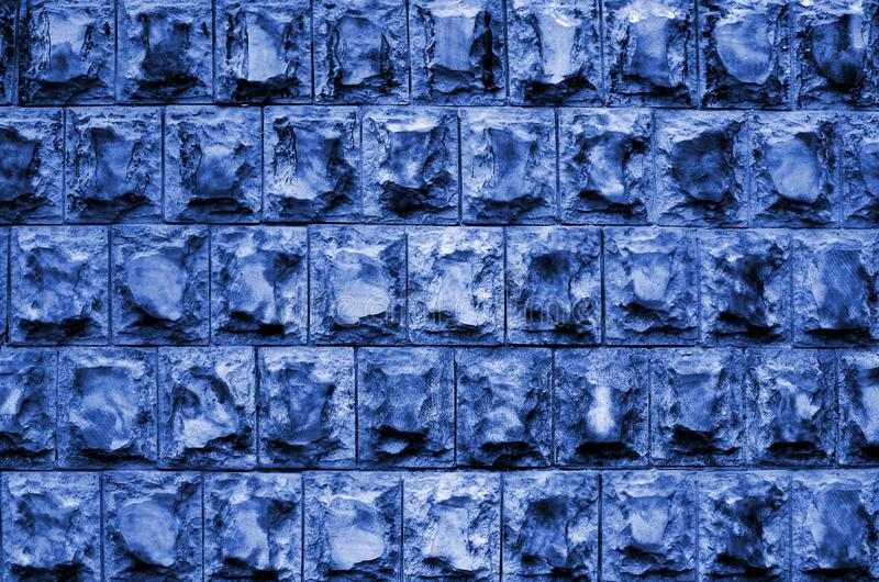 Texture design of the foundation or walls of buildings in the form of rectangular tiles made of solid granite stone with sharp royalty free stock photography