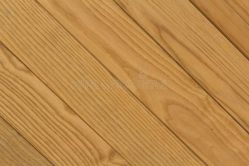 Texture of Diagonal Brown Wooden Bars for Background. A realistic image of diagonal wooden bars texture with brown color for background royalty free stock photos