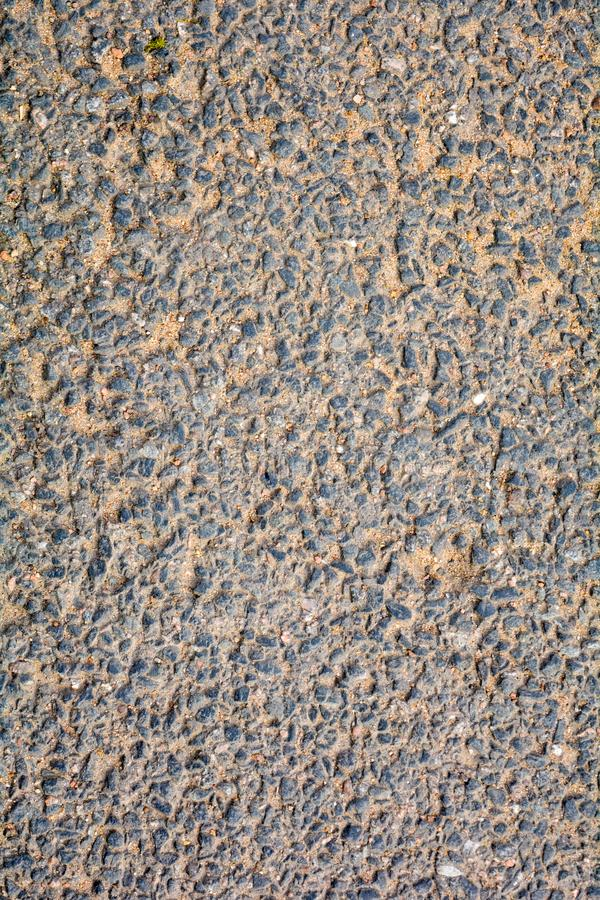 Texture of dirty asphalt with sand. Rough surfaceas as abstract texture stock photography