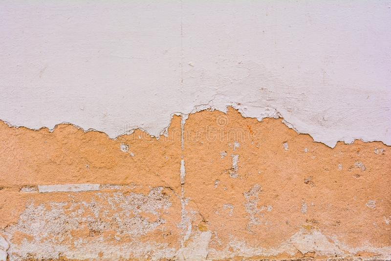 Texture of dirty destroyed concrete wall with exfoliated layer of white paint royalty free stock images