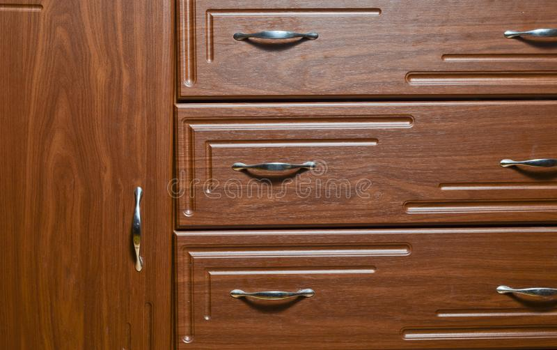 Texture of the door of a wooden bedside table. royalty free stock image