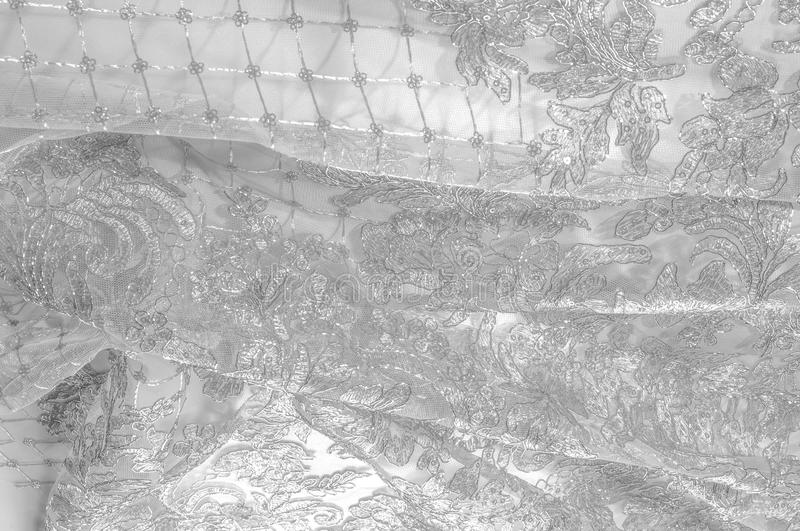 Texture. Drawing. background. Silver lace fabric. You fell in lo. Ve with the appearance of a richly decorated filigree and stretched lace, and in some of our stock image