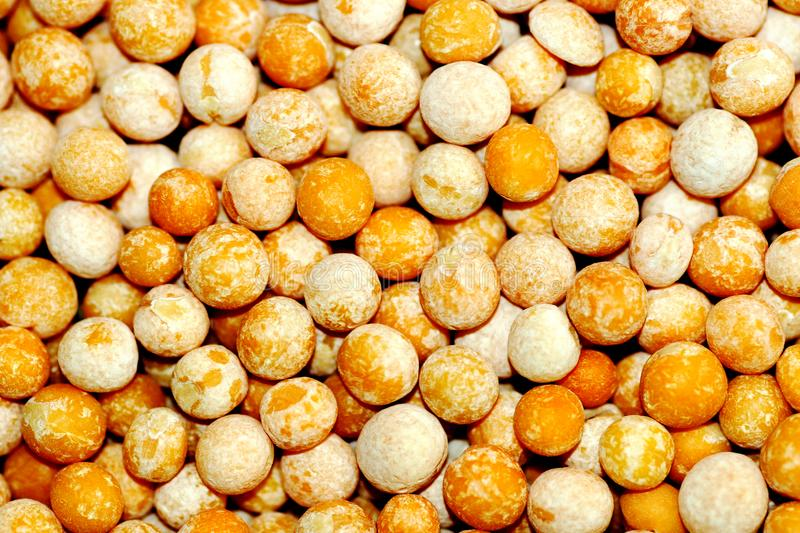 The texture of dry beans,healthy food,organic product,yellow. Food background nature color texture organic close-up healthy white ripe seed group orange stock photos