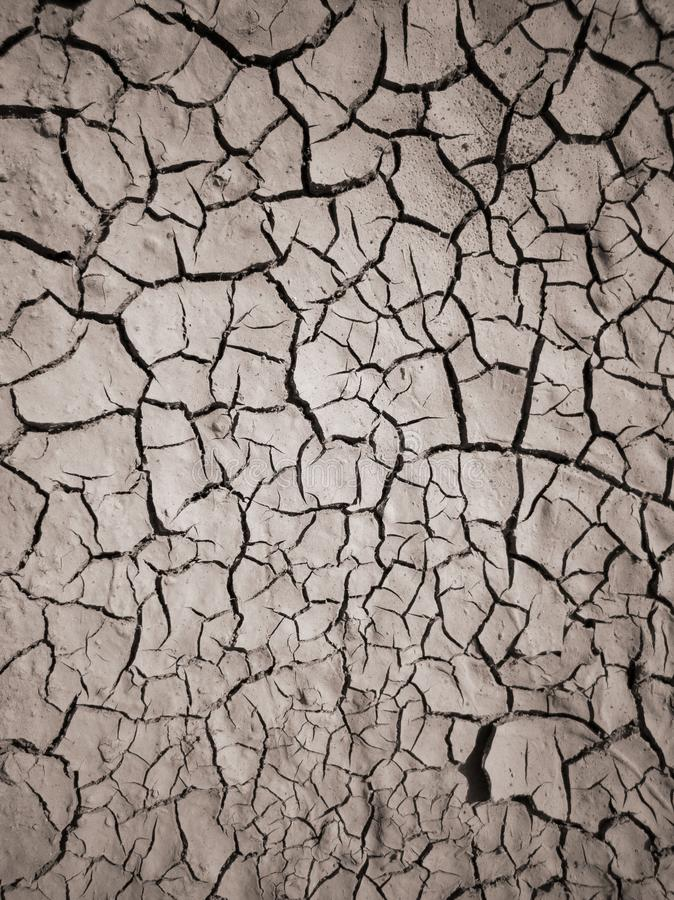 Texture of dry cracked earth. The desert background. The global shortage of water. Deep cracks in brown land as symbol of hot stock photo