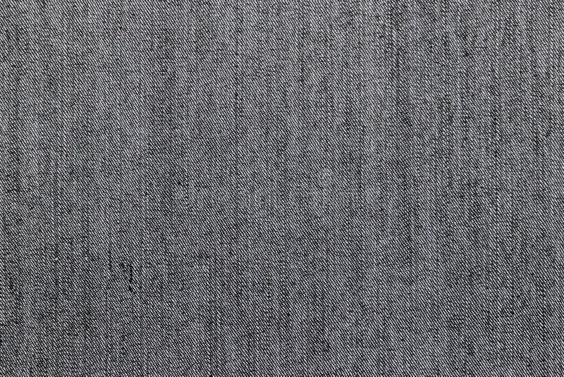 Texture du côté intérieur d'un tissu gris de denim photographie stock libre de droits